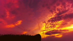 The man stand on the mountain against the background of sunset. Time lapse Stock Footage