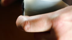 Detail Of Hand Using A Gaming Controller In A Video Game Stock Footage