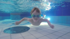 Child swims in the pool. Slow motion Stock Footage