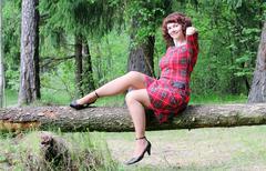 Woman on a log Stock Photos