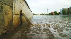 Sewage Pipe Discharging Into The River. The drain carries sewage Stock Footage