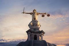 Justice On The Old Bailey, London with a sunset background - stock photo
