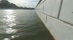 Low angle view of river water surface and cement wall Stock Footage