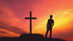 The man stand near the cross against the cloud flow. Time lapse Stock Footage