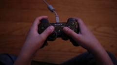 Kid Playing Video Game on Controller Stock Video Stock Footage