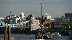 Old ship on River Thames, Tower Bridge, London - stock footage