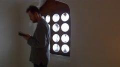 Man Standing at the Window Book in His Hands Tourist in Church Chapel Inside Stock Footage