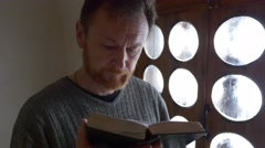 The Believer Prays and Reads at the Window Tourist in Church Chapel Inside the Stock Footage