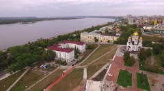 copter flies from church to embankment of Samara city - stock footage