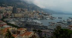 Time lapse of Monaco, Monte Carlo, with clouds billowing over limestone cliffs Stock Footage
