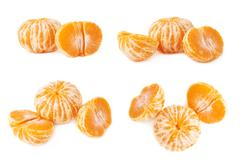 Two halves anh whole fresh juicy tangerine fruit isolated over the white Stock Photos