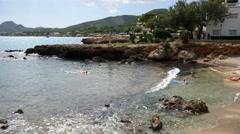 Cala Ratjada Mallorca Majorca: Girls floating in sea on lilo Stock Footage