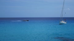 Cala Ratjada Mallorca Majorca: Speedboat and sailboat passing by on sea Stock Footage