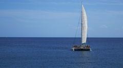 Cala Ratjada Mallorca Majorca: Catamaran party boat Stock Footage