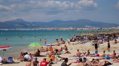 El Arenal Mallorca Majorca: People relaxing on beach Stock Footage