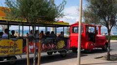El Arenal Mallorca Majorca: Tourist train on promenade Stock Footage