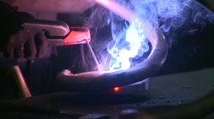 Metallurgical industrial factory: a man soldering parts. Stock Footage