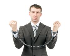 Business man wearing suit in handcuffs Stock Photos