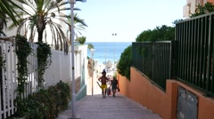 Magaluf Mallorca Majorca: Couple with kid coming out the beach Stock Footage