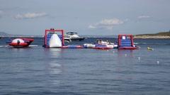 Magaluf Mallorca Majorca: Tourist on water bouncy castle water toys fun Stock Footage