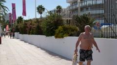Magaluf Mallorca Majorca: Tourists walking on sidewalk beachwalk promenade Stock Footage