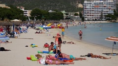Palma Nova Mallorca Majorca: Tourists on beach and in sea Stock Footage