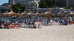 Palma Nova Mallorca Majorca: People on beach and in sea - stock footage
