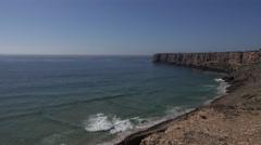 4k Beautiful rough coastline cliffs and beach Sagres Portugal Stock Footage