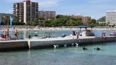 Palma Nova Mallorca Majorca: Divers in water - stock footage