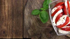 Fresh made Tomato Mozzarella Salad (loopable; 4K) Stock Footage