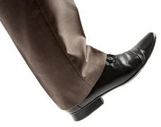Feet of man in black shoes - stock photo