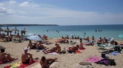 Playa de Palma Mallorca Majorca: Tourists sunbathing on the beach Stock Footage