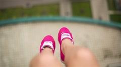 Female Legs In Pink Sneakers Swinging Stock Footage