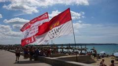 Playa de Palma Mallorca Majorca: Flags on beach Stock Footage