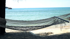 View of empty hammock on exotic beach, super slow motion 240fps Stock Footage