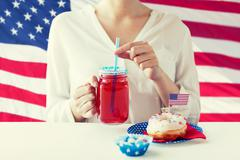 woman celebrating american independence day - stock photo