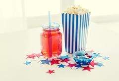 drink and popcorn with candies on independence day - stock photo