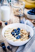 Breakfast: oatmeal with bananas, blueberries, chia seeds and almonds Stock Photos