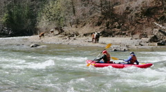 An active kayakers on the rough water. Two kayakers paddling hard the kayak with - stock footage