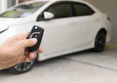 Closeup of male hand holding remote control car key Stock Photos