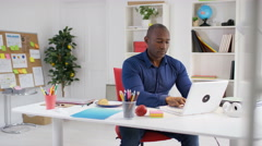 4K Business entrepreneur with startup company working at his desk in home office Stock Footage
