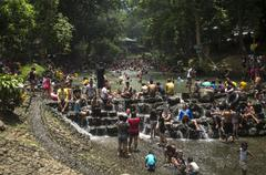 People crowding on cool river water on summer - stock photo