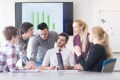 young business people group on meeting at modern office - stock photo