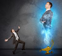 Genie business man appearing from magic lamp - stock photo