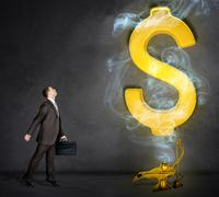 Dollar sign appearing from magic lamp - stock photo