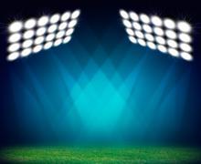 Green soccer field, illuminated spotlights Stock Illustration