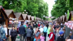 People walk and do purchases at the fair - stock footage