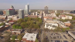 Aerial footage approaching downtown Raleigh, NC on a spring morning. Stock Footage