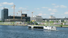 Berlin. Touristboat driving on spree river along Stock Footage
