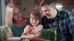 Family biting tasting cheese and smiling at camera Stock Footage